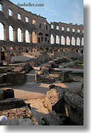 amphitheater, architectural ruins, archways, buildings, cloisters, croatia, europe, pula, roman, structures, vertical, photograph
