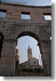 amphitheater, architectural ruins, archways, bell towers, buildings, churches, croatia, europe, pula, roman, structures, towers, vertical, photograph