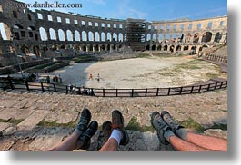 amphitheater, architectural ruins, archways, buildings, croatia, europe, horizontal, legs, pula, roman, structures, photograph