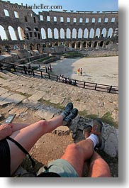 amphitheater, architectural ruins, archways, buildings, croatia, europe, legs, pula, roman, structures, vertical, photograph