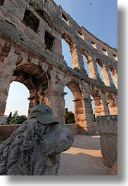 amphitheater, architectural ruins, archways, buildings, croatia, europe, lions, pula, roman, structures, vertical, photograph