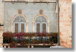 archways, croatia, europe, flowers, horizontal, pula, structures, windows, photograph