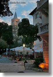 arbiana hotel, bell towers, croatia, dining, dusk, europe, rab, tents, vertical, photograph