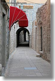 archways, awnings, croatia, europe, narrow streets, rab, streets, structures, vertical, walkway, photograph