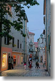 croatia, dusk, europe, glow, lights, narrow, rab, streets, trees, vertical, photograph