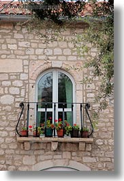 archways, balconies, croatia, europe, plants, rab, structures, vertical, windows, photograph