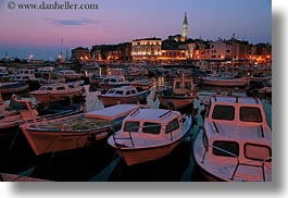 bell towers, boats, buildings, croatia, dusk, europe, glow, harbor, horizontal, lights, nature, rovinj, sky, structures, sun, sunsets, towers, transportation, photograph