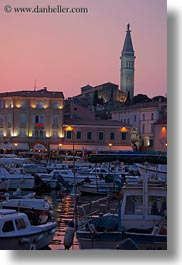 bell towers, boats, buildings, croatia, dusk, europe, glow, harbor, lights, nature, rovinj, sky, structures, sun, sunsets, towers, transportation, vertical, photograph
