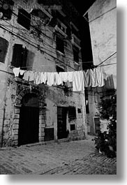 black and white, clothes, cobblestones, croatia, europe, hangings, laundry, materials, narrow streets, rovinj, stones, streets, vertical, photograph