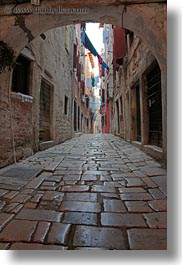 archways, clothes, cobblestones, croatia, europe, hangings, laundry, materials, narrow, narrow streets, rovinj, stones, streets, structures, vertical, photograph