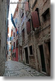 clothes, cobblestones, croatia, europe, hangings, laundry, materials, narrow, narrow streets, rovinj, stones, streets, vertical, photograph