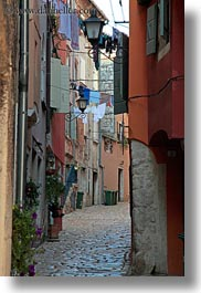 cobblestones, croatia, europe, hangings, laundry, materials, narrow, narrow streets, rovinj, stones, streets, vertical, photograph