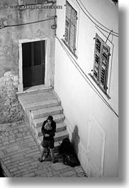 black and white, couples, croatia, europe, hugging, narrow streets, people, rovinj, slow exposure, streets, vertical, photograph