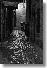 black and white, cobblestones, croatia, europe, materials, motorcycles, narrow streets, roads, rovinj, stones, streets, vertical, photograph