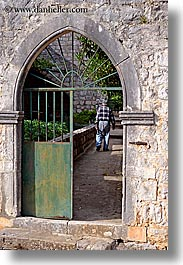 arches, croatia, doors, europe, gates, green, irons, men, sipan, vertical, photograph