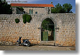arches, croatia, doors, europe, horizontal, motorcycles, sipan, photograph