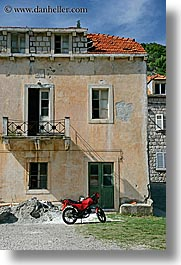 buildings, croatia, europe, motorcycles, red, sipan, vertical, photograph