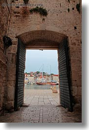 archways, buildings, croatia, doors, europe, harbor, structures, trogir, vertical, photograph