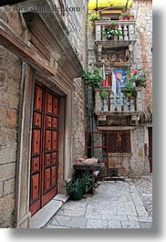 balconies, buildings, croatia, doors, europe, ornate, stones, trogir, vertical, photograph
