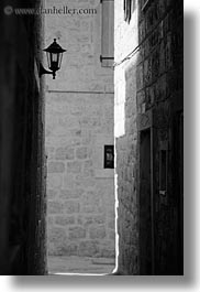 black and white, croatia, europe, lamp posts, lamps, narrow streets, streets, trogir, vertical, photograph