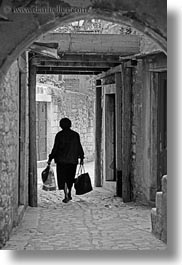 bags, black and white, carrying, croatia, europe, narrow streets, streets, trogir, vertical, womens, photograph