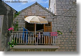 balconies, croatia, display, europe, horizontal, trogir, umbrellas, windows, photograph