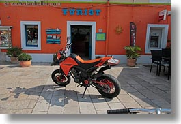 colorful, colors, croatia, europe, horizontal, motorcycles, oranges, signs, tourists, veli losinj, photograph