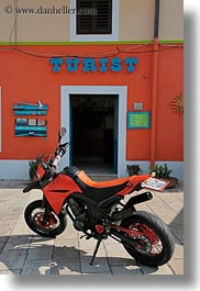 colorful, colors, croatia, europe, motorcycles, oranges, signs, tourists, veli losinj, vertical, photograph
