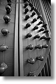 arts, black and white, czech republic, europe, heads, knobs, prague, vertical, photograph
