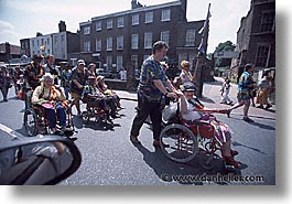 chairs, cities, england, english, europe, horizontal, london, parade, people, united kingdom, wheels, photograph