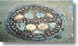 cities, england, english, europe, horizontal, london, manholes, streets, united kingdom, photograph