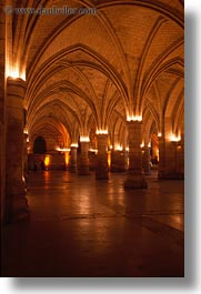 buildings, conciergerie, europe, france, glow, interiors, lights, paris, vertical, photograph