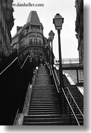 black and white, buildings, europe, france, going, lamp posts, lights, paris, perspective, stairs, upview, vertical, photograph