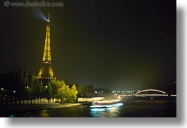 boats, buildings, eiffel, eiffel tower, europe, france, glow, haze, horizontal, light streaks, lights, nature, nite, paris, rivers, structures, towers, transportation, water, photograph