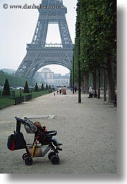 babies, buildings, eiffel tower, europe, france, haze, paris, stroller, structures, towers, vertical, photograph