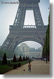 boys, buildings, eiffel tower, europe, france, haze, paris, playing, soccer, structures, towers, vertical, photograph