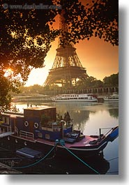 boats, buildings, eiffel tower, europe, france, glow, lights, nature, paris, rivers, seine, structures, sunrise, towers, transportation, vertical, water, photograph