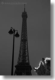 black and white, buildings, dusk, eiffel tower, europe, france, glow, lamp posts, lights, paris, structures, towers, vertical, photograph