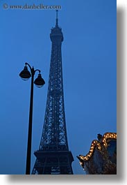 buildings, dusk, eiffel tower, europe, france, glow, lamp posts, lights, paris, structures, towers, vertical, photograph