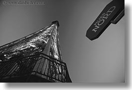 black and white, buildings, eiffel tower, europe, france, glow, horizontal, lights, north, paris, perspective, signs, structures, towers, upview, photograph