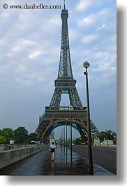 buildings, clouds, eiffel tower, europe, france, nature, paris, pedestrians, sidewalks, sky, structures, towers, vertical, photograph