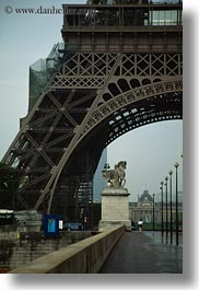 buildings, eiffel tower, europe, france, haze, paris, pedestrians, sidewalks, structures, towers, vertical, photograph
