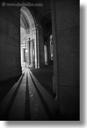 arches, black and white, europe, france, lights, louvre, paris, shadows, vertical, photograph