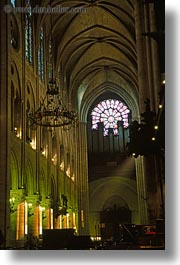 archways, churches, europe, france, glow, lights, materials, notre dame, paris, stained glass, vertical, photograph