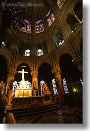 crosses, domes, europe, france, glow, lights, materials, notre dame, paris, stained glass, statues, under, vertical, photograph