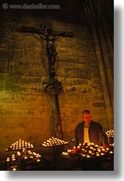 candles, europe, france, glow, lighting, lights, men, nite, notre dame, paris, vertical, photograph