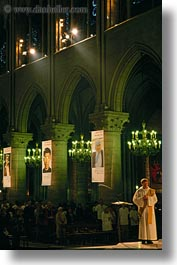 europe, france, glow, green, lights, nite, notre dame, paris, priests, vertical, photograph