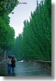 conceptual, couples, emotions, europe, france, paris, people, romantic, umbrellas, vertical, walking, photograph