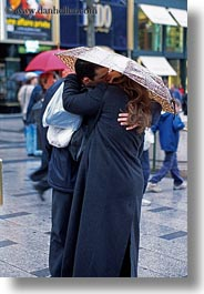 conceptual, emotions, europe, france, kissing, lovers, paris, people, romantic, umbrellas, vertical, photograph