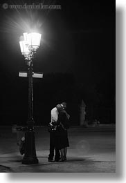 black and white, europe, france, kissing, lovers, nite, paris, people, vertical, photograph